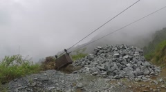 A box on a conveying line carrying rocks outside of a mine Stock Footage