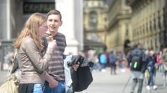 Girl turist eating Ice Cream near Duomo e Galleria Vittorio Emanuele Stock Footage