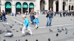 Pigeons near the Duomo in Milan city center - children run the birds Stock Footage