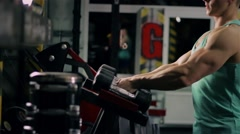 Handsome athletic man taking dumbbells and go to the bench to do sport exercize  Stock Footage