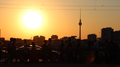 Street life in Berlin at sunset - silhouette of walking people Stock Footage