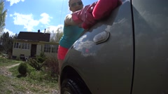 Sponge Squeezing On Car, Girl Scrub The Car On Sunlight Stock Footage