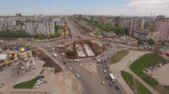 Drone flies over building road tunnel Stock Footage