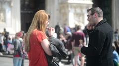 Man and Woman eating Ice Cream near Duomo e Galleria Vittorio Emanuele Stock Footage