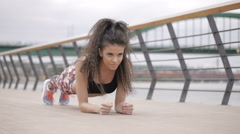 Beautiful black haired, curly fitness model, stretching and exercising outdoor Stock Footage