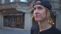 Young female tourist looking around the street in the city centre slow motion Stock Footage