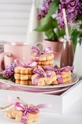 Cookies on a white tray with mugs, chocolate milkshakes and lilac flowers Stock Photos