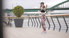 Beautiful black haired, curly fitness model, exercising outdoor Stock Footage