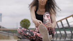 Beautiful black haired, curly fitness model, prepairing for exercise Stock Footage