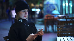 young woman using a smartphone at the cafeteria slow motion - stock footage