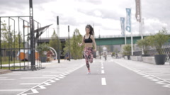 Beautiful black haired, curly fitness model, jogging, running fast Stock Footage