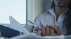 4K Beautiful young businesswoman writing in notebook during train journey Stock Footage