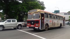 COLOMBO, SRI LANKA traffic moving, a bus and other vehicles passing Stock Footage