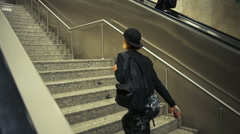 Young sportive woman goes upstairs instead using escalator slow motion Stock Footage