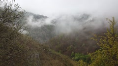 In spring the veil of mist creeping up the mountain slopes of the Caucasus - stock footage