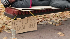 Lady helping poor homeless man by throwing dollars in can, charity, poverty Stock Footage