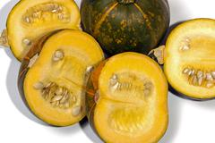 Close Up Shot of Four Yellow Halved Gem Squash on White Stock Photos