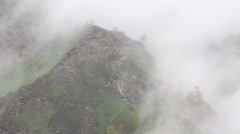 In spring the veil of mist creeping up the mountain slopes of the Caucasus Stock Footage