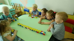 Educational games, little children playing with coloured cubes in a kindergarten - stock footage