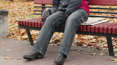 Manual worker sleeping drunk on bench, problems with health, unhealthy lifestyle Stock Footage