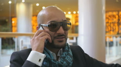 Arab businessman talking on mobile phone - stock footage