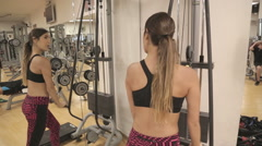 Woman do pulleys streches at the gym Stock Footage