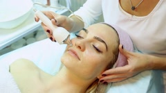 Woman doing cosmetic procedures in spa clinic. - stock footage