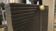 Changing the weights of a gym bodybuilding equipment - stock footage