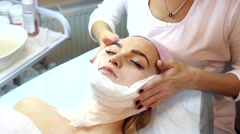 Cleansing and exfoliating facial. Stock Footage