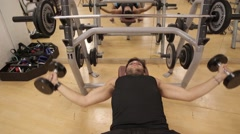 Man train with weights at the gym Stock Footage