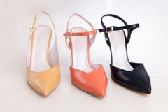 Many different high heels shoes for summer. Stock Photos
