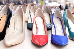 Many different high heels shoes for summer. - stock photo