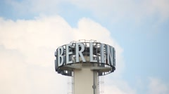 The spinning logo of the Berlin Verlag in Berlin, Germany. Stock Footage