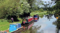 People preparing narrow boats on English canal Stock Footage