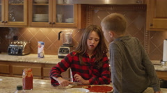A family making homemade pizza together in the kitchen Stock Footage