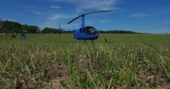 Helicopters are  at the airfield. - stock footage