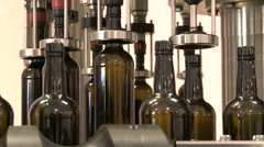 Bottles on a industrial machine. Bottling machine. Stock Footage