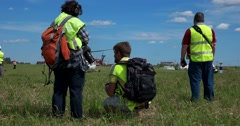 Slalom helicopters. The referees and photographers on the airfild.  Air show. Stock Footage