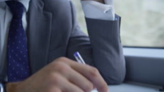 4k, serious businessman planning meetings on his mobile phone on commuter train. Stock Footage