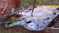 Palette with oil paints. Outdoors Stock Footage