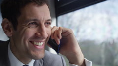 4k Attractive smiling businessman making mobile phone call on train journey Stock Footage