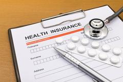 health insurance application form - stock photo