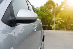 Wing mirror of car. Sun shining. Kuvituskuvat