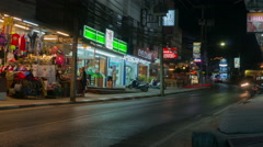 Phuket, Thailand, May 2016: Traffic in night road, time lapse Stock Footage