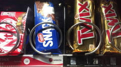 Twix candy bar purchased from European vending machine 4k Stock Footage