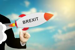 business hand clicking brexit or british exit rocket - stock illustration