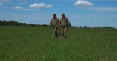 Two pilots are on the green airfield. Stock Footage