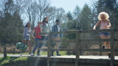 4K Carefree hipster friends hiking stop to take a look at the view Stock Footage