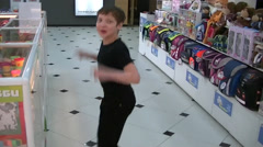 Boy jumping for joy Stock Footage