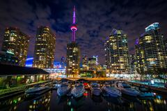 Marina and buildings at the Harbourfront at night, in Toronto, Ontario. Stock Photos